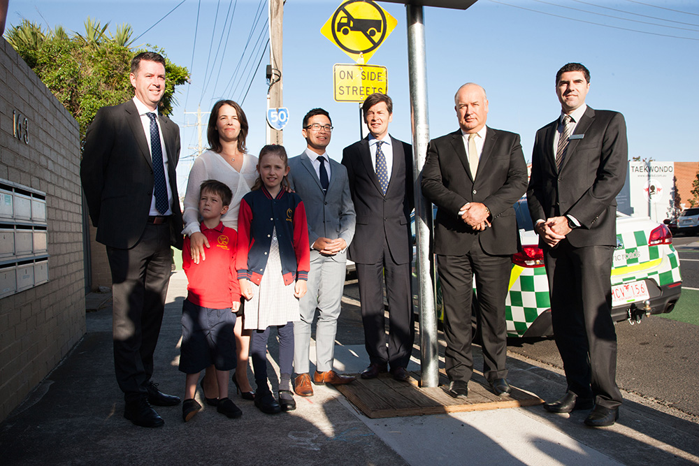 Wade Noonan member for Williamstown, Samantha McArthur MTAG President, Mayor of Maribyrnong Nam Quach, Minister for Roads, Road Safety and Ports, Luke Donellan, CEO of the VTA Peter Anderson, Adam Maquire, Regional Director, Metro North West at VicRoads along with Kingsville Primary School students William McArthur and Edith Dillon.